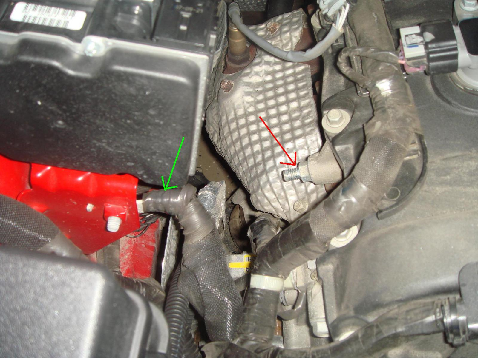 The arrow in red shows the engine ground stud located on the passenger side  under the engine cover. The green arrow shows how it is grounded to the  body of ...